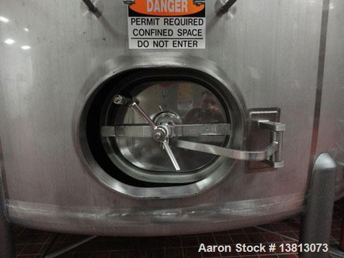 "Used-Cherry Burrell Model CVL 10,000 Gallon Side Agitated Tank. Includes 5 hp, 3485 rpm Tri Clover 2 1/2"" x 2"" transfer pump..."