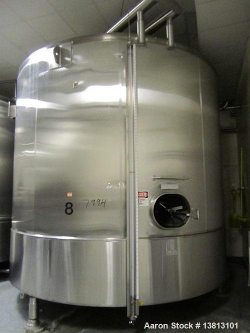 Used-Cherry Burrell 8000 Gallon Vertical Stainless Steel Tank.Top mounted agitator, dual impeller, bearing block, side manwa...