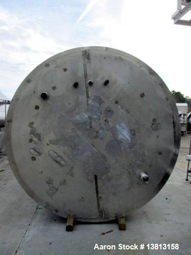 Used- 6,000 Gallon Stainless Steel Storage Tank. Approximately 98'' diameter x 16' straight wall, side manhole. Inlets 2 - 3...