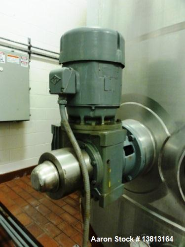 Used- 10,000 Stainless Steel Single Shell Mixing Tank. Domed top, sloped bottom mixing tank with vent on top, bottom side ma...
