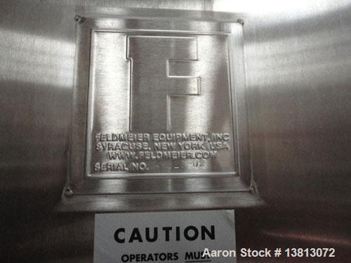 "Used-Feldmeier 10,000 Gallon Top Agitated Mix Tank. Includes 5 hp, 3485 rpm, Tri Clover 2 1/2"" x 1 1/2"" transfer pump. Dish ..."
