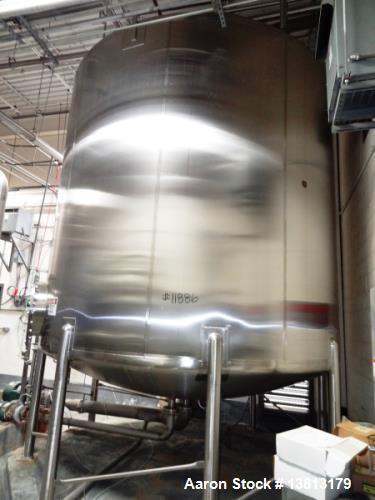 """Used- Feldmeier 9,000 Gallon Vertical Storage Tank, Stainless Steel. Dish top and dish bottom with center 6"""" 150lb discharge..."""