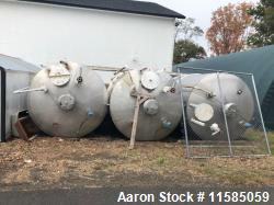 Used- Approximately 5000 Gallon Vertical Stainless Steel Storage Tank
