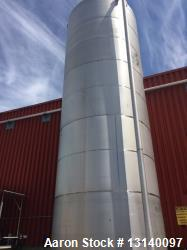 Used- Approximately 30,000 Gallon Stainless Steel Vertical Tank