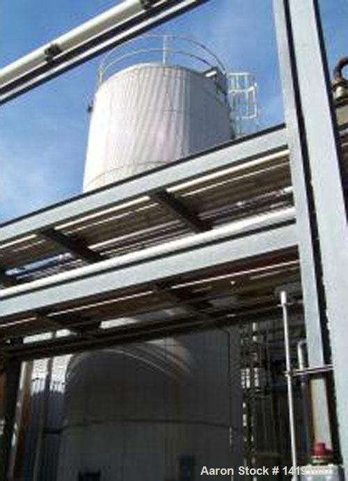 Used- RECO Tank, 31,300 Gallon, 304L Stainless Steel, Vertical. Slight cone top, flat bottom. 12' diameter x 37' tall. API-6...