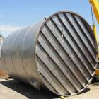 Used- 12,000 Gallon Vertical Stainless Steel Tank. Dome Top and Sloped Bottom. Diameter is 144
