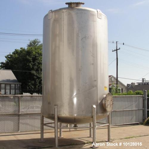 Used- Walker 5000 Gallon 304 Stainless Steel Vertical Tank. This tank has a dome top and a dish bottom. The tank diameter is...