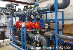 https://www.aaronequipment.com/Images/ItemImages/Water-Treatment-Equipment/Water-Treatment-Equipment/medium/Ultra-Filtration_50628001_aa.jpg